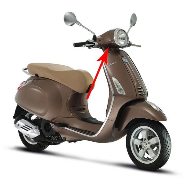 Stuurkap Vespa Primavera bruin 129 a onder Piaggio origineel 67364700md
